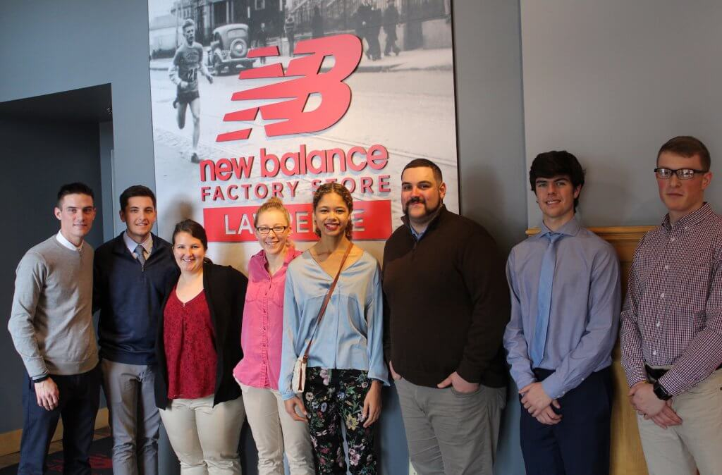 Nichols students stand in front of New Balance sign